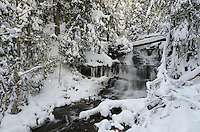 Beautiful Wagner Falls surrounded by a winter wonderland in mid-November. Munising, MI