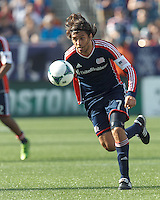 New England Revolution midfielder Juan Carlos Toja (7) on the attack.  In a Major League Soccer (MLS) match, the New England Revolution (blue) defeated LA Galaxy (white), 5-0, at Gillette Stadium on June 2, 2013.