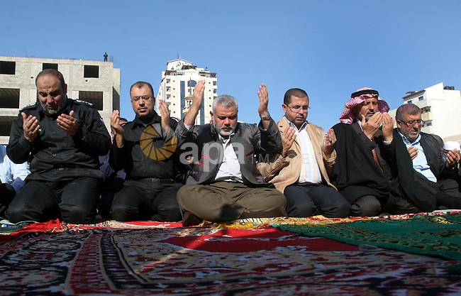 Palestinian Prime Minister in Gaza strip , Ismail Haniya prays with Palestinian men in Gaza City on December 5, 2010 during special Muslim prayers known as Salat al-Istisqa -- a ritual practiced since the time of the Prophet Mohammed. Photo by Mohammed Asad