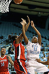 05 December 2012: North Carolina's Brittany Rountree (11) shoots over Radford's La-She' Walker (left). The University of North Carolina Tar Heels played the Radford University Highlanders at Carmichael Arena in Chapel Hill, North Carolina in an NCAA Division I Women's Basketball game. UNC won the game 64-44.