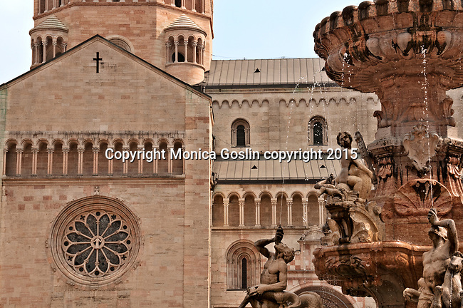 Piazza Duomo with the late Baroque Fountain of Neptune in the center and the Cathedral in the background in Trento, Italy