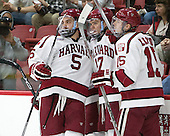 Clay Anderson (Harvard - 5), Sean Malone (Harvard - 17) and Seb Lloyd (Harvard - 15) celebrate a Malone goal. - The Harvard University Crimson defeated the visiting Rensselaer Polytechnic Institute Engineers 5-2 in game 1 of their ECAC quarterfinal series on Friday, March 11, 2016, at Bright-Landry Hockey Center in Boston, Massachusetts.