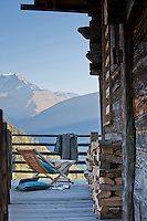 The rustic chalet is surrounded by a weathered decking with spectacular views over Mont Blanc