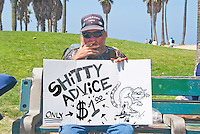 Steve Moore gives 'shitty advice' for $1.00 at Venice Beach on Sunday, July 15, 2012.