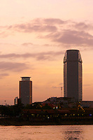 Phnom Penh, Cambodia. Sunset cruise to the confluence of Tonle Sap and Mekong river. High rise buildings.