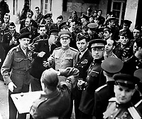 Marshall Zhukov decorates Field Marshall Montgomery with the Russian Order of Victory.  Allied chiefs who attended the cermony at Gen. Eisenhower's Headquarters at Frankfurt are about to drink a toast.  June 10, 1945.  British Official.  (OWI)<br /> NARA FILE #:  208-AA-342BB-1<br /> WAR &amp; CONFLICT BOOK #:  1097