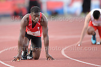 International athletics at Cardiff International stadium, Cardiff, South Wales - Tuesday 15th July 2014<br /> <br /> Christian Malcolm (L) prepares to run his final race before retiring from athletics. <br /> <br /> <br /> Photo by Jeff Thomas Photography