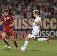 USA midfielder Stuart Holden (22) shoots as Czech Republic midfielder Libor Sionko (7) closes. In the Send Off Series, the Czech Republic defeated the US men's national team, 4-2, at Rentschler Field in East Hartford, Connecticut, on May 25, 2010.