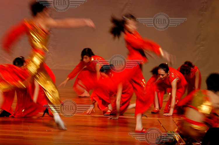 Dancers perform at a welcoming party for new students at Zhaoqing University.