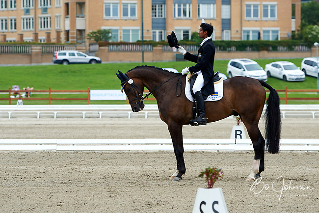 Theodor Wahren (SWE) riding EX2000 during the dressage test at Malmo City Horse Show. FEI World Cup Eventing Qualifier CIC***. <br /> The couple was with 67,78 % placed 10th after Friday's dressage.<br /> Eventing in Ribersborg, Malmo, Sweden. Ribersborg is very close to Malmo city seen in the background.<br /> August 2011.<br /> Only for editorial use.