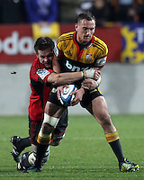 Chiefs' Aaron Cruden is tackled by Crusaders' Richie McCaw in the semi-final Super Rugby match, Waikato Stadium, Hamilton, New Zealand, Friday, July 27, 2012.  Credit:SNPA / David Rowland