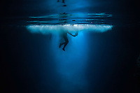 Diver jumps from the side of limestone cave to make a spectacular impact. (Photo by Underwater Photographer Matt Considine)