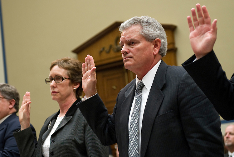 """UNITED STATES - APRIL 16: Former GSA Administrator Martha Johnson; and Jeff Neely, regional commissioner of the Public Buildings Service, Pacific Rim Region, are sworn-in before a House Oversight and Government Reform Committee hearing on """"Addressing the General Services Administration's (GSA) Culture of Wasteful Spending."""" Neely took the 5th amendment and refused to answer questions. (Photo By Chris Maddaloni/CQ Roll Call)"""