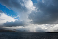 Dramatic skies over rising mountain peaks of Vesteralen viewed from Hadselfjord, Norway