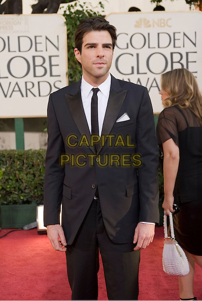 ZACHARY QUINTO.Arrivals at the 66th Annual Golden Globe Awards held at the Beverly Hilton Hotel, Beverly Hills, California, USA..January 11th, 2009.*Editorial Use Only* .globes full length black suit half 3/4.CAP/AWF/HFPA .Supplied by Capital Pictures.