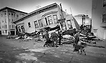 The day after the Loma Prieta Earthquake, a search and rescue team with dogs goes through rubble looking for life in the Marina, on Divisadero and Bay streets October 18, 1989.