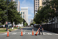 A police officer moves cones inside the security perimeter for the Democratic National Convention on Monday, September 3, 2012 in Charlotte, NC.