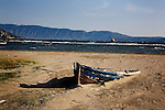 Destroyed fishing boat on the Old beach in Vlore