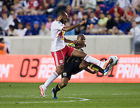 Julius James (26) of the Columbus Crew fights for the ball with Thierry Henry (14) of the New York Red Bulls during the game at Red Bull Arena in Harrison, NJ.  The New York Red Bulls tied the Columbus Crew, 1-1.