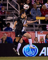 Heather O'Reilly (9) of the USWNT goes up for a header with Ali Riley (7) of New Zealand during an international friendly at Crew Stadium in Columbus, OH. The USWNT tied New Zealand, 1-1.