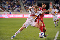 Gonzalo Segares (13) of the Chicago Fire challenges Dax McCarty (11) of the New York Red Bulls for the ball. The New York Red Bulls and the Chicago Fire played to a 2-2 tie during a Major League Soccer (MLS) match at Red Bull Arena in Harrison, NJ, on August 13, 2011.