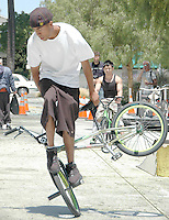 Richard Aguayo from Skate Park Association Street Team performs stunts on a BMX during Santa Monica Public Library's bicycles and cycling iCycle festival on Saturday, May 22, 2010.