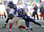 Seattle Seahawks free safety Earl Thomas (29) and cornerback Richard Sherman wraps up San Francisco 49ers running back Shaun Draughn (24) at CenturyLink Field in Seattle, Washington on November 22, 2015.  The Seahawks beat the 49ers 29-13.   ©2015. Jim Bryant Photo. All RIghts Reserved.