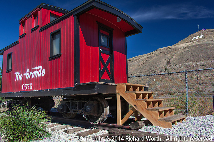 Tenderfoot Mountain, some call it S Mountain, stands as stoic background to the recent addition to the visitor center in Salida, Colorado.  A bright red caboose, the former 'playhouse' of the donor.