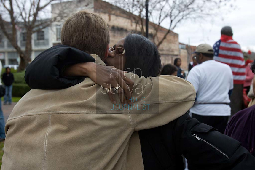 Venisha Brown, daughter of singer James Brown and one-time backup singer Yvonne Fair, with Augusta, Ga. mayor Deke Copenhaver by a statue of the hometown singer on Broad Street. James Brown died in Atlanta on Monday, Dec. 25.<br />