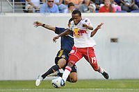 A.J. DeLaGarza (20) of the Los Angeles Galaxy tackles Dane Richards (19) of the New York Red Bulls. The Los Angeles Galaxy defeated the New York Red Bulls 1-0 during a Major League Soccer (MLS) match at Red Bull Arena in Harrison, NJ, on August 14, 2010.
