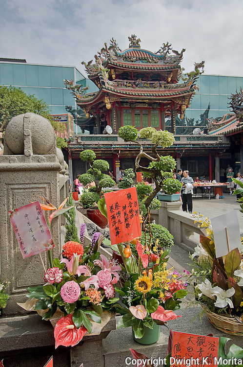 Flowers are set next to temple in memoriam