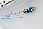 5 December 2014:  Andrey Bogdanov and Andrey Medvedev, sliding for Russia, bank into Curve 10 on their second run, ending the day with a 8th place finish and a combined 2-run time of 1:28.523 in the Men's Doubles Competition at the Viessmann Luge World Cup, at the Olympic Sports Track in Lake Placid, New York, USA. Mandatory Credit: Ed Wolfstein Photo *** RAW (NEF) Image File Available ***