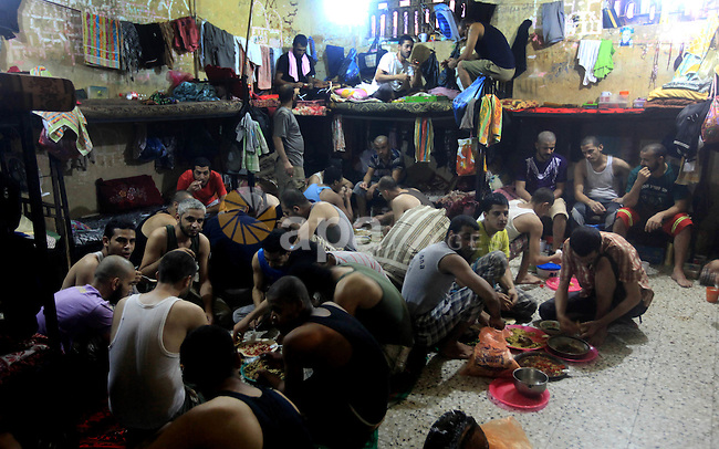 Palestinian inmates break their fast during the holy month of Ramadan at prison controlled by the Hamas police in Gaza city on 29 July 2012. Hamas police released more than 150 criminal inmates before the fasting month of Ramadan. Photo by Majdi Fathi