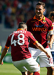 Calcio, Serie A: Roma-Bologna. Roma, stadio Olimpico, 16 settembre 2012..AS Roma midfielder Alessandro Florenzi, celebrates with teammate Francesco Totti, right, after scoring during the Italian Serie A football match between AS Roma and Bologna, at Rome, Olympic stadium, 16 September 2012. .UPDATE IMAGES PRESS/Isabella Bonotto