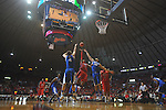 Ole Miss guard Dundrecous Nelson (5)  shoots between Kentucky's Jon Hood (4)  and Kentucky's Eloy Vargas (30) at the C.M. &quot;Tad&quot; Smith Coliseum in Oxford, Miss. on Tuesday, February 1, 2011. Ole Miss won 71-69.