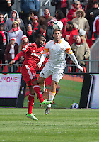 20 April 2013: Toronto FC defender Gale Agbossoumonde #6 and Houston Dynamo forward Will Bruin #12 in action during an MLS game between the Houston Dynamo and Toronto FC at BMO Field in Toronto, Ontario Canada..The game ended in a 1-1 draw...