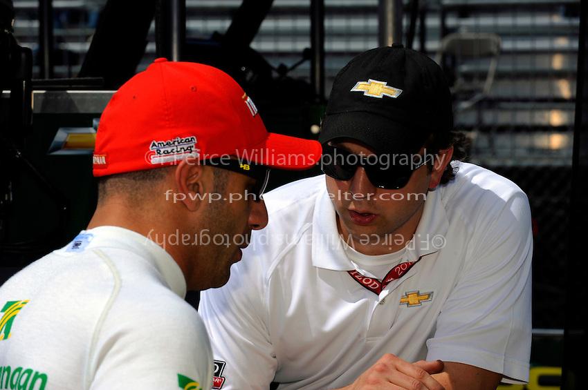 Tony Kanaan (#11) talks with a Chevy engineer.