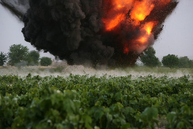 A blast rigged by a bomb disposal team destroys a Taliban cache of about 80 pounds of TNT found by U.S. soldiers with Company A,  2nd Battalion, 2nd Infantry Regiment in the village of Mira Hor in Kandahar province, Afghanistan. April 18, 2009. DREW BROWN/STARS AND STRIPES