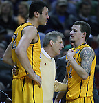 Wyoming Head Coach Larry Shyatt ,center, hugs his players Larry Nance (22) and Josh Adams (14) near the end of their game against Northern Iowa in the 2015 NCAA Division I Men's Basketball Championship March 20, 2015 at the Key Arena in Seattle, Washington.   Northern Iowa beat Wyoming 71 to 54.   ©2015.  Jim Bryant Photo. All Rights Reserved.