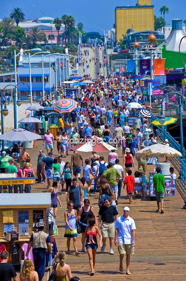 Pacific Park, Santa Monica, CA, Pier, Boardwalk, Ferris Wheel, Roller Coaster, Amusements, Holiday, Walking, playing, Tourist, Beach, water, sand, California, USA,