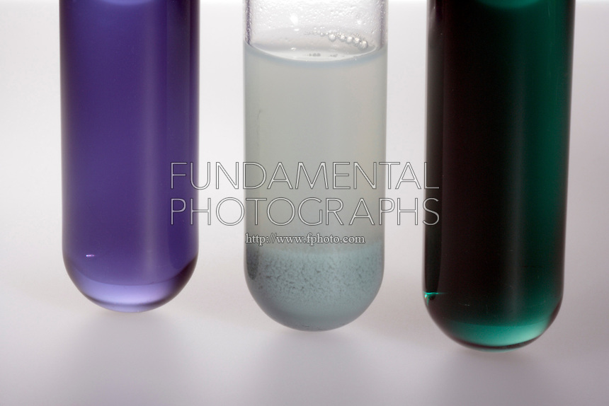 CHROMIUM (III) HYDROXIDE- EXAMPLE OF AMPHOTERISM<br /> 3 Oxidation States of Chromium<br /> The center test tube contains a 0.1M solution of Cr(NO3)3 to which 1.0M NaOH has been added to form a suspension of Cr(OH)3.  (Left)  adding 6M HCl produces violet Cr3+ ion &amp; (right) adding an excess of NaOH forms the green [Cr(OH)4]B ion.