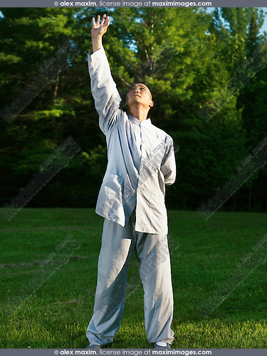 Shaolin monk practicing sunrise Qi Gong in the nature