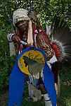 Jonathan Smith, Shinnecock  Native American wearing Men's Traditional Regalia at the Thunderbird Pow Wow in Queens County Farm, NY. Examples of ethnic pride, heritage, celebration, and traditional folk art crafts.