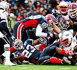 20 December 2009: Buffalo Bills' running back Marshawn Lynch (23) is tackled during a game against the New England Patriots at Ralph Wilson Stadium in Orchard Park, New York. The Patriots defeated the Bills 17-10. Mandatory Credit: Ed Wolfstein Photo