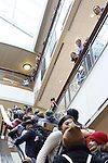 Onlookers watch as student take over Baker Center during the #HandsUpWalkOut march.Photo by Olivia Wallace