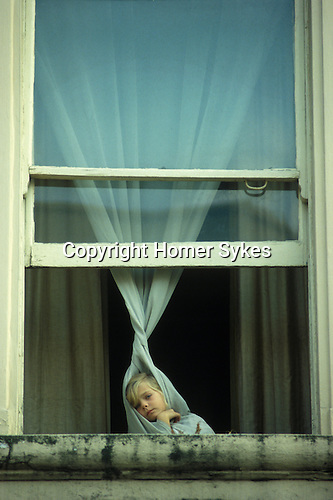 Girl in window at the Notting Hill London England