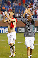 7 June 2011: USA Men's National Team midfielder Landon Donovan (10) and midfielder Michael Bradley (4) salutes the fans after the CONCACAF soccer match between USA and Canada at Ford Field Detroit, Michigan. USA won 2-0.