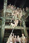 """Men dressed in only a """"fundoshi"""" cloth thong climb up the """"uchizuna,"""" a thick rope usually used to sound a temple gong, during the Hadaka Mairi at Fukuman Kokuzoson Enzoji Temple in Yanaizu, Fukushima Prefecture, Japan. The winter ritual, variations of which exist throughout Japan, is undertaken by males alone as a purification ritual. It has its origins in an ancient folk legend, in which the people of Yanaizu underwent a quest to drive away the Dragon God, who lived in the Tadami River, which flows through the town, and who had entered the town in order to steal the treasure of Enzoji Temple, where the main event of the Hadaka Mairi is held. It has been an annual tradition for more than a thousand years and today participants write wishes on their arms and torsos asking for success in business or for their favorite sports team."""