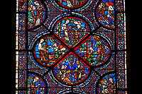 Medieval Windows  of the Gothic Cathedral of Chartres, France, dedicated to the life an miracles of St Nicholas. A UNESCO World Heritage Site. Bottom corner shows During a famine, Nicholas persuades sailors to give the town some grain, bottom left shows The sailors bringing grain ashore . Centre panel bottom, The young St Nicholas does well at school, left Nicholas secretly gives gold to an old man to save his daughters , right The old man tries to thank Nicholas, who humbly flees from him, top .Nicholas is chosen to be the new Bishop of Myra.  .