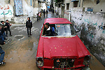 Palestinian students play in a crashed car while they back from their school after a study day in the southern Gaza strip town of Rafah, Jan. 31, 2013. Photo by Eyad Al Baba